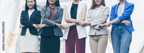 Group of business women holding hands support team Fototapet