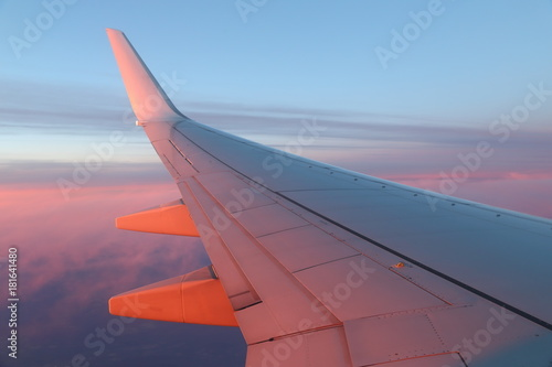 View from window on wing of plane in flight