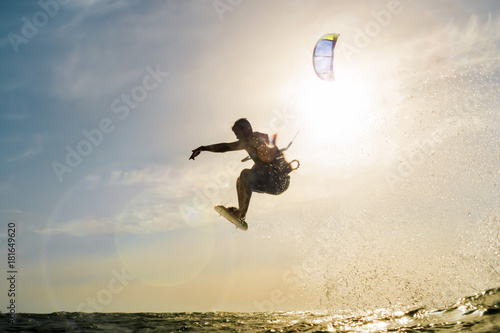Surfer flying in front of the sunset