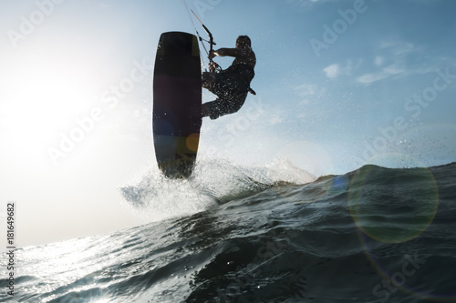 Surfer jumping a wave in front of the camera