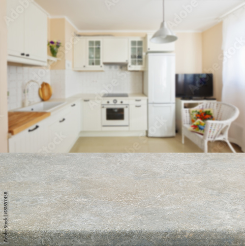 Empty Kitchen Stone Table Top With White Modern In Background