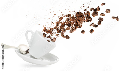 Deurstickers Cafe coffee beans and powder spilling out of a cup isolated on white