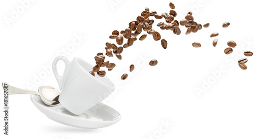 Keuken foto achterwand Cafe coffee beans spilling out of a cup isolated on white