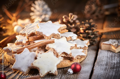 Christmas background with table of cinnamon cookies