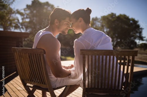Couple sitting together on chair at safari vacation