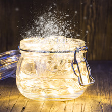 Magic Christmas Garland With Bright Lights Inside A Glass Jar