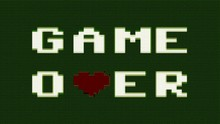 A Game Over Text Message Appearing On A Computer Screen, A Red Heart Replacing A Letter. ASCII Art 8 Bit Vintage PC Terminal Animation Fx, From The Time When Computers Didn't Have Pixel Graphics.