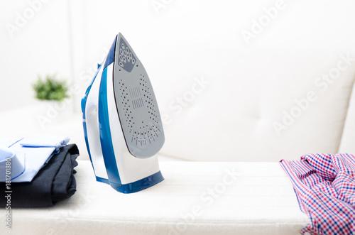 Fotografie, Obraz  Steam blue iron on ironing board