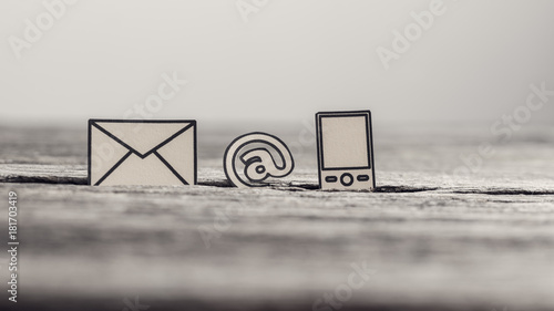 Photo Communication icons telephone, at sign and mail