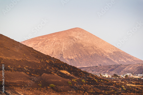 Foto op Aluminium Diepbruine A stunning view of the volcanic landscape from the crater of the volcano El Cuervo. Lanzarote. Canary Islands. Spain