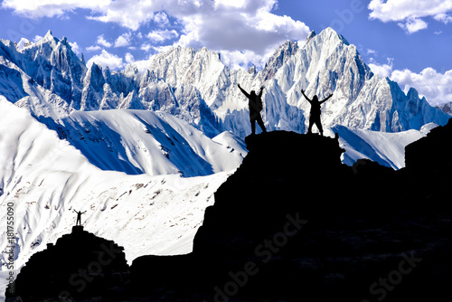 Fotografie, Obraz  successful team in the majestic, challenging and summit mountains