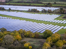 Aerial View Of A Modern Solar Farm In Autumn / Fall In The English Countryside