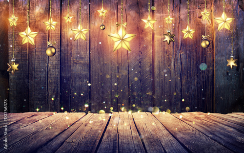 In de dag Retro Glowing Christmas Stars Hanging At Rustic Wooden Background