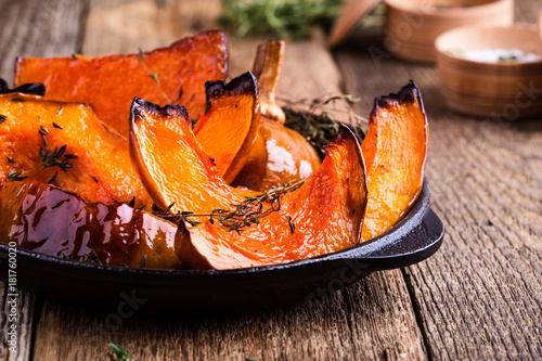Baked pumpkin with thyme in cast iron skillet Canvas Print