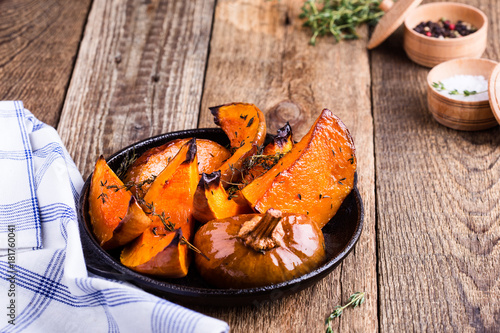 Baked pumpkin with thyme in cast iron skillet Poster