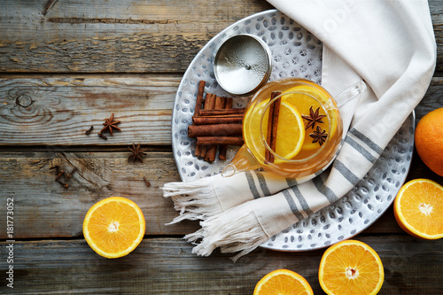 Photo sur Toile The Hot orange tea with spices on wooden rustic background