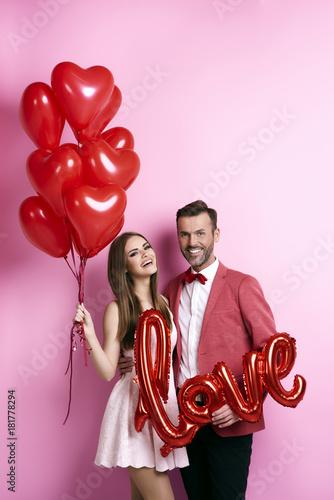 Fotografie, Obraz  Front view of man embracing her girlfriend