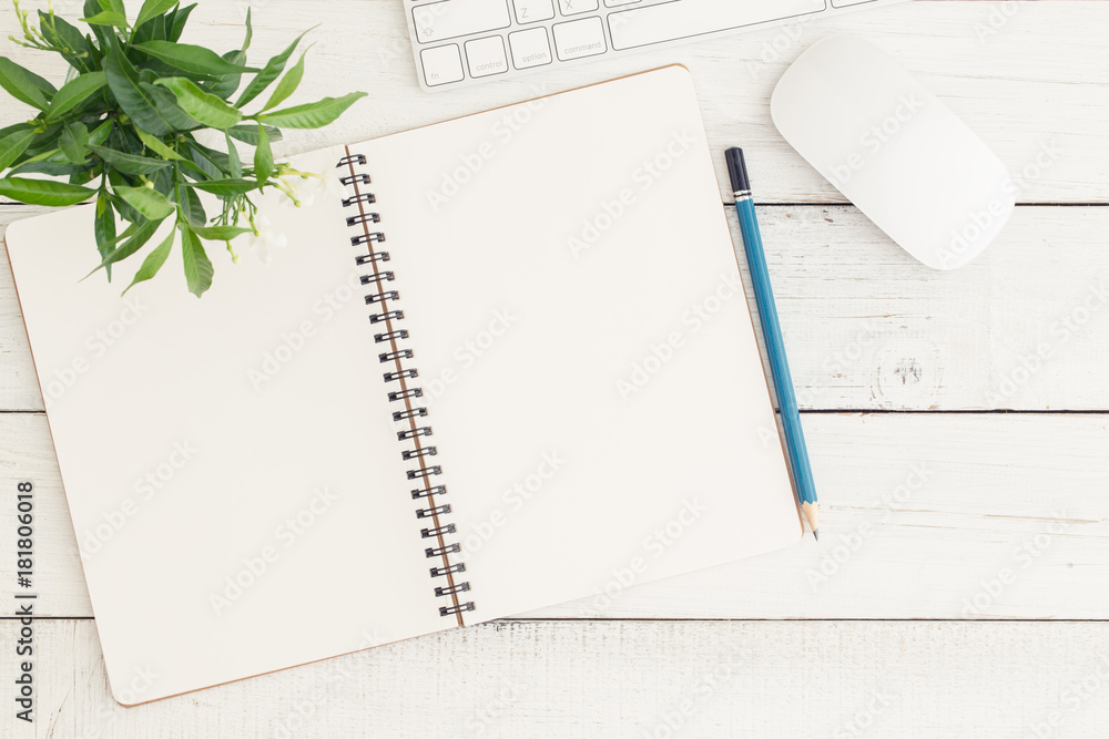 Fototapeta Flat lay photo of office desk with mouse and keyboard,Empty open notebook on white wood table top view