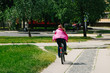 Girl with a guy riding in a park on a bicycle
