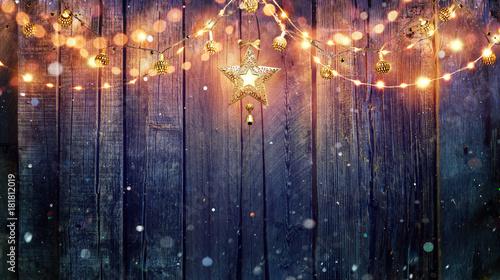 String Light Hanging At Vintage Wooden Background