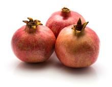 Three Pomegranate Isolated On White Background.