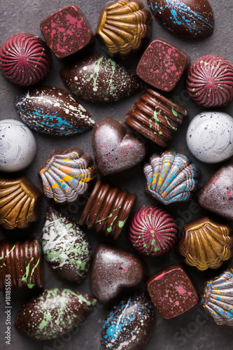 Photo Stands South America Country Colored chocolate candies. Creative sweets on a gray background.