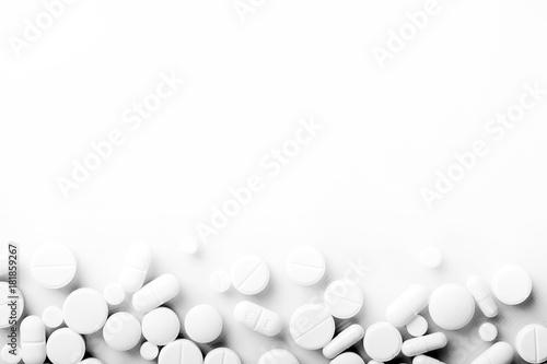 Photo sur Toile Pharmacie Pharmacy theme, white medicine tablets antibiotic pills.