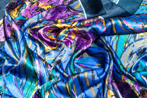 Fotobehang Paradijsvogel bloem Texture, fabric, background. Women's scarf. Silk fabric is blue, floral pattern. Abstraction
