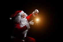 Santa Claus With A Lantern Isolated On White Background.