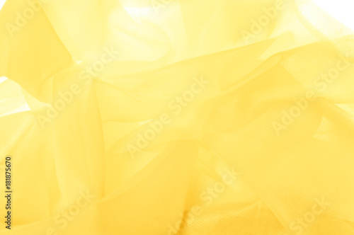 Fototapety, obrazy: Texture, background, pattern. The texture of the silk fabric is yellow. Silk fabric is transparent.