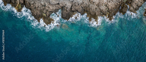 Montage in der Fensternische Luftaufnahme Aerial view of sea waves and fantastic Rocky coast, Montenegro