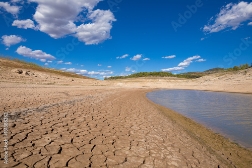 landscape of low level water and dry earth ground in advance, extreme drought in Entrepenas reservoir, in Guadalajara, Castile, Spain, Europe
