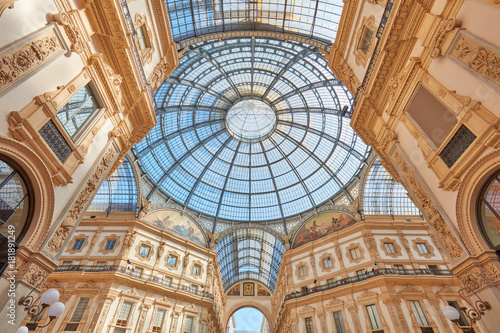 Garden Poster Milan Milan, Vittorio Emanuele gallery interior, wide angle view in a sunny day. The gallery hosts many luxury fashion shop of the italian fashion capital.