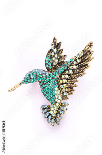 Fotografie, Obraz  Brooch colibri with color diamonds isolated on white
