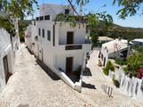 Fototapeta Uliczki - White houses and narrow streets in Alte, Portugal