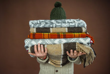 Man Holding Pile Of Blankets