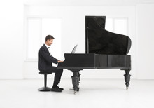 Young Man Playing Piano Indoors