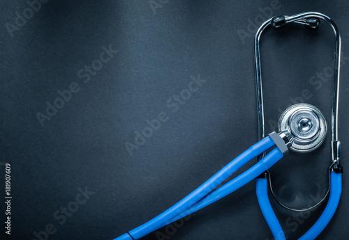 Fototapeta Stethoscope on black background top view medicine concept obraz na płótnie
