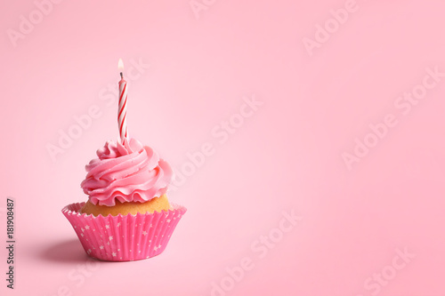 Delicious cupcake with candle on pink background Wallpaper Mural
