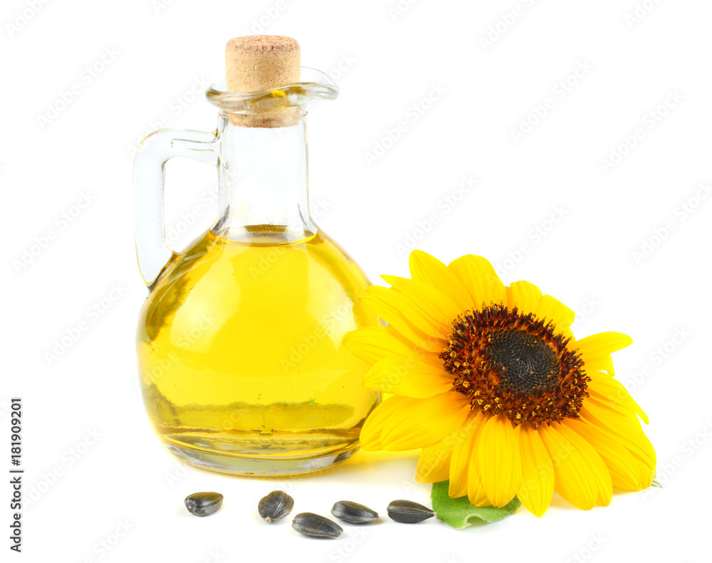 Fototapeta Sunflower oil in glass jug, seeds and flower isolated on white background