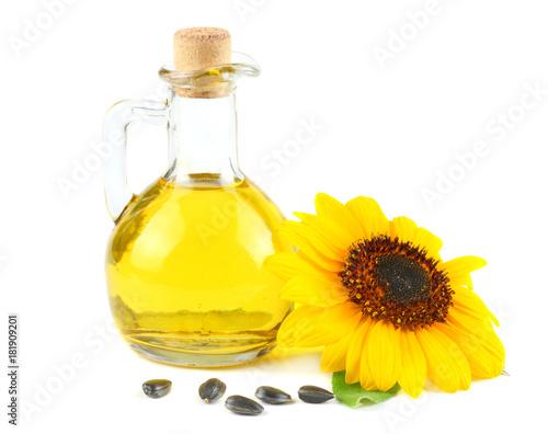 Fototapeta Sunflower oil in glass jug, seeds and flower isolated on white background obraz