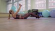 Young woman doing fitness indoors, doing stretching. girl shakes the press. healthy lifestyle and sports. the camera moves.