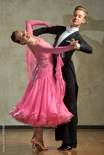 Fotografia Attractive young couple of children dancing ballroom dance in studio