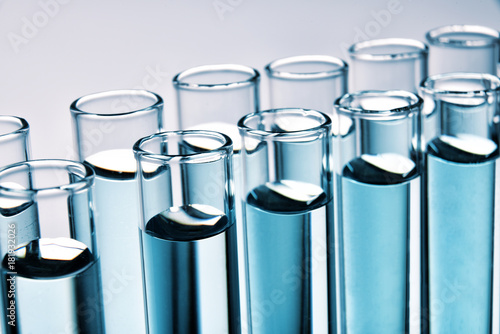 Row of full test tubes background Canvas Print