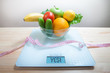 Fruits, vegetables on the scales. Measuring tape. Juice. Healthy eating. Diet.