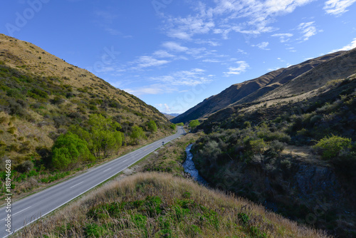 Deurstickers Asia land Road in the valley in New Zealand Southland
