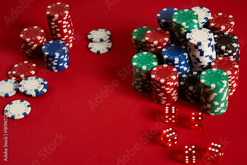 Poker chips on red background плакат