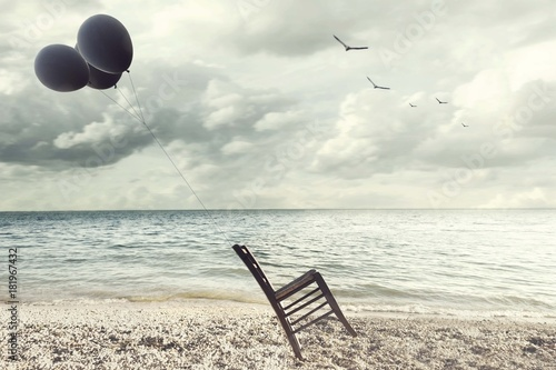 Fotografia, Obraz surreal image of a chair held in balance by flying balloons