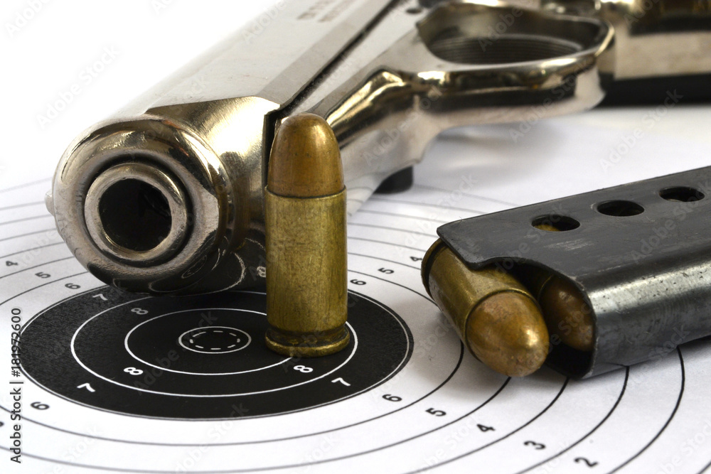 Fototapeta Pistol and ammunition