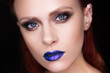 Beautiful girl with bright make-up blue lips